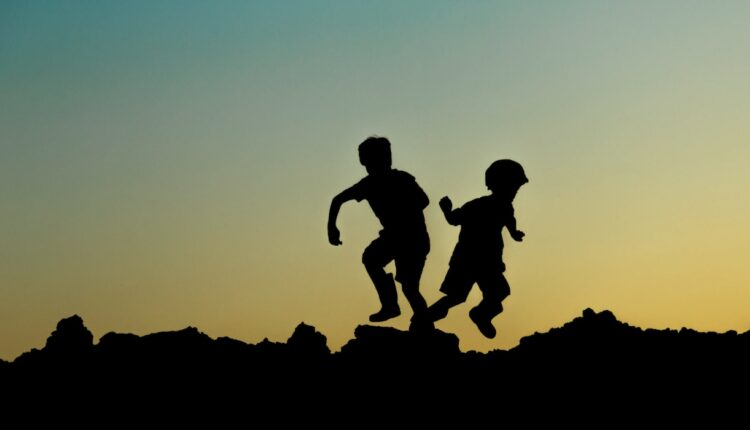 kids-playing-on-rocky-hill-independent-pubdomain-Margaret-Weir.jpg